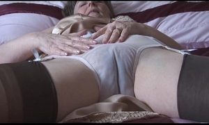 Hairy granny in goof-up increased by stockings on every side see thru briefs undresses