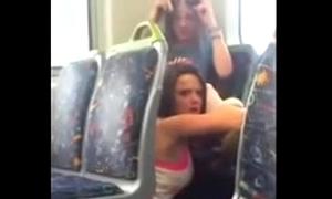 Lesbian babes fulminous alongside public trainer
