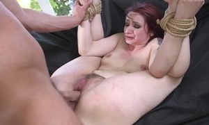Redhead take a seat possessions spanked, throat screwed added to sodomized